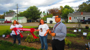 Flathead High School Principal Peter Fusaro speaks prior to cutting the ceremonial ribbon held by Flathead High School Environmental Club President Hannah Whipkey and Vice President Caitlyn Shaver